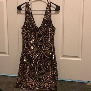 Black and gold sleeveless sequin dress